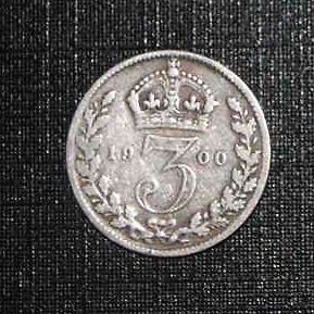 Silver three pence in christmas pudding england
